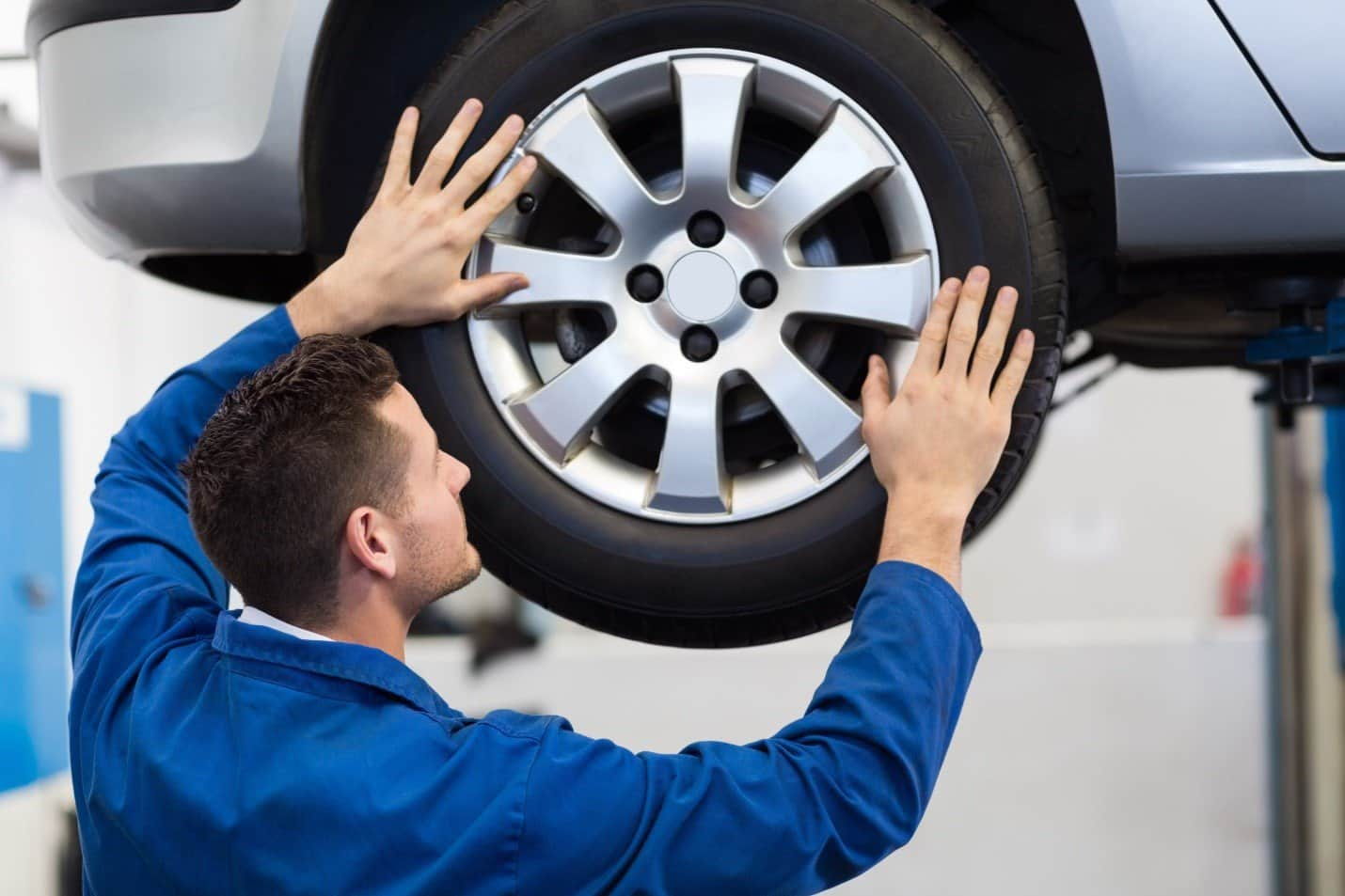 Technician repairing car tire